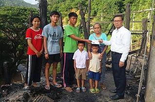 Ajan Wittaya on relief trip.jpg