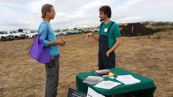 Matt Powers talks to a young farmer