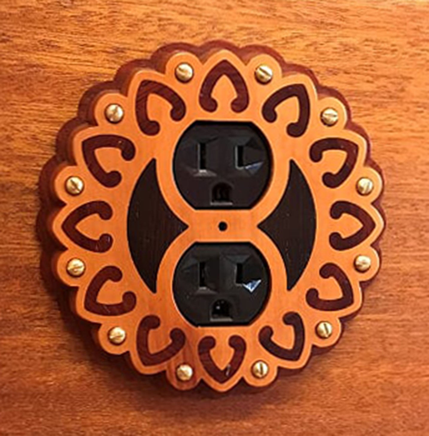 Outlet cover inspired by sconce