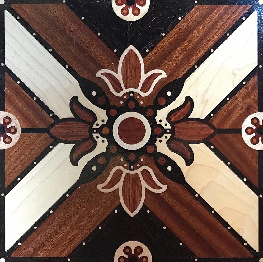 Fleur de lis tile in parquet floor