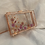 Thumbnail: Wildflower x Happy Clays Rose Gold Floral Clutch