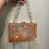 Thumbnail: Wildflower x Happy Clays Rose Gold Mist Floral Clutch w/ Two Detachable Straps