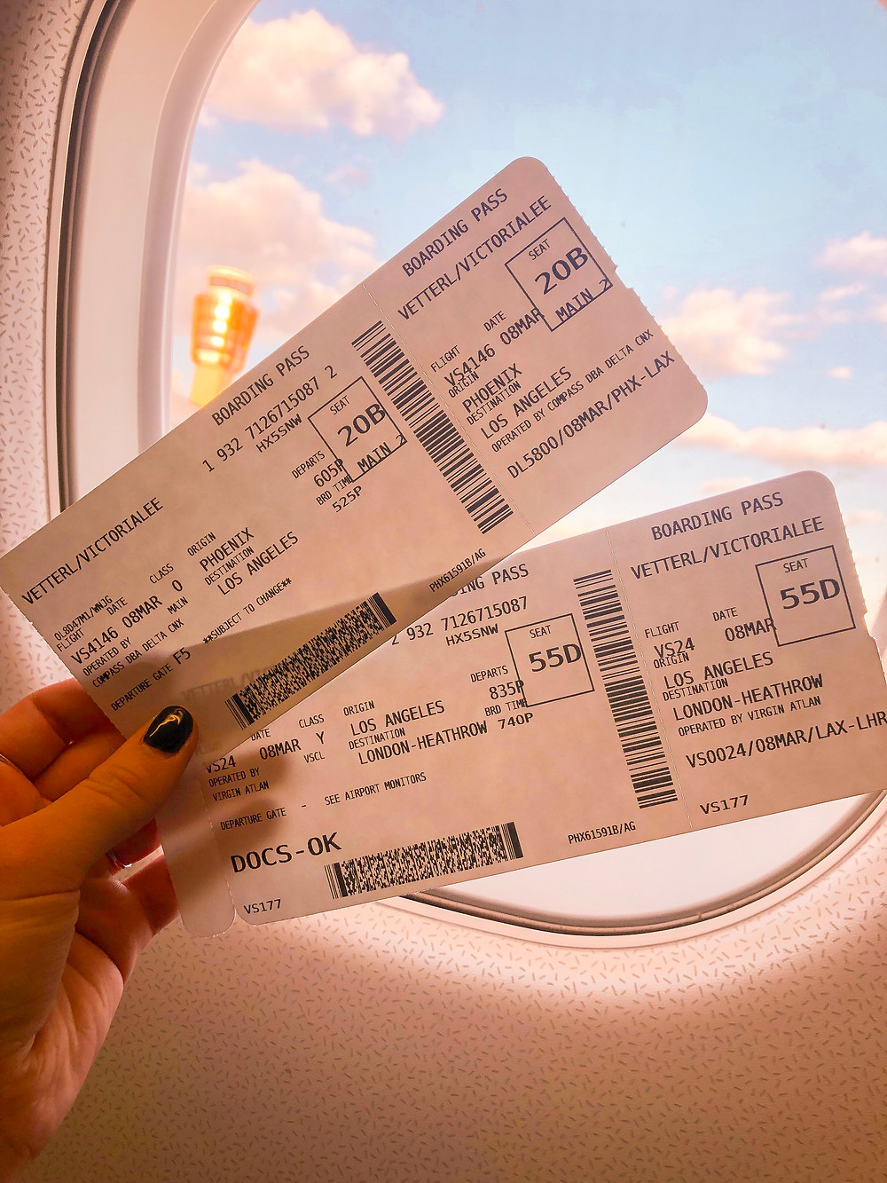 plane tickets in front of a window