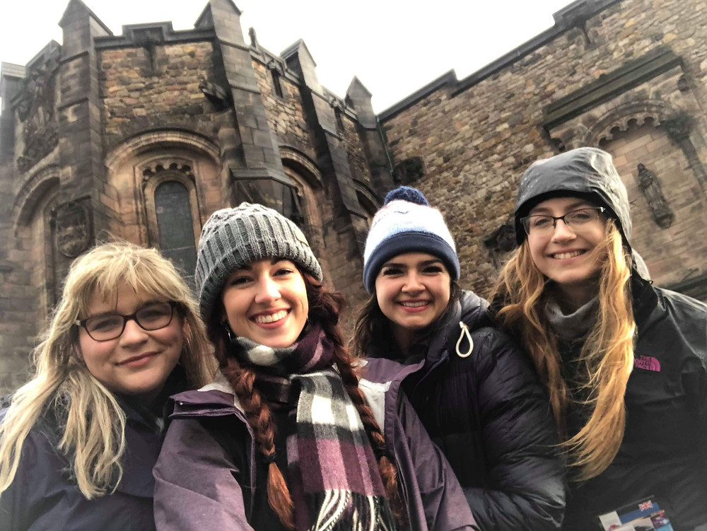 Selfie of four friends in front of Edinburgh Castle