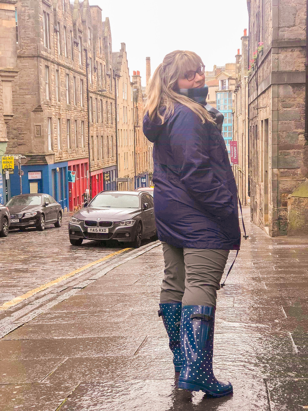 girl walking on a street in Edinburgh