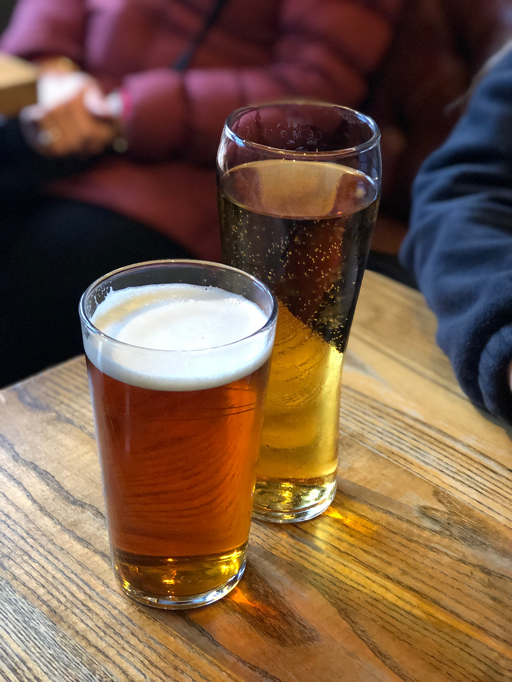 Pints of beer and cider in The Last Drop Pub in Edinburgh, Scotland