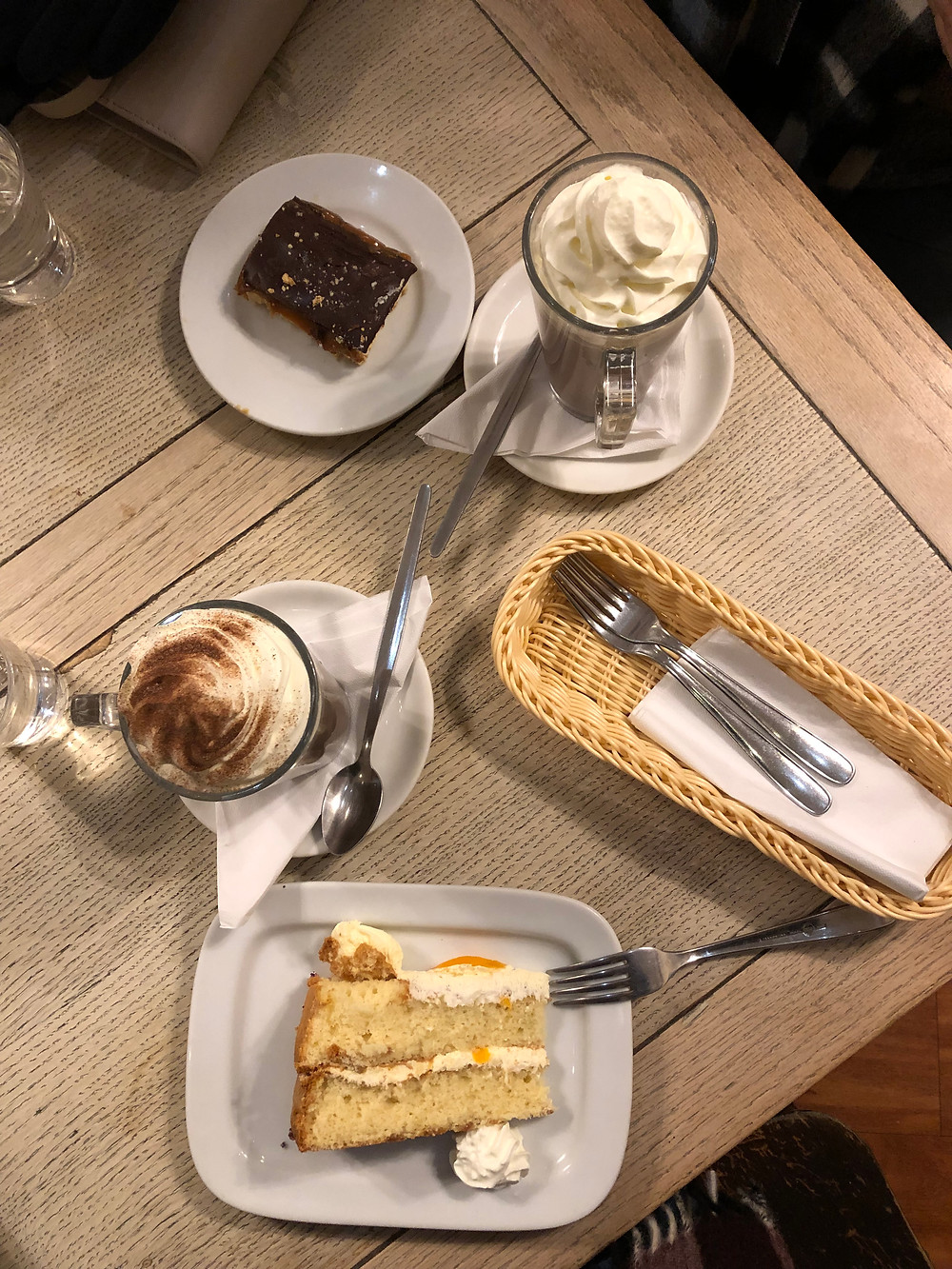 Millionaire shortbread, cake, and espressos in a cafe