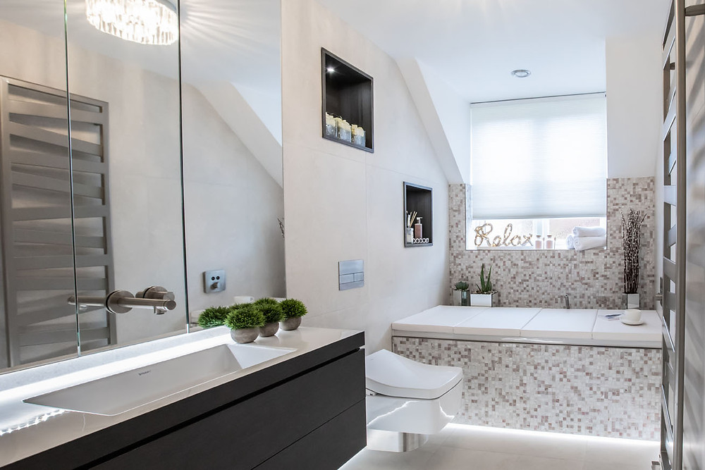 Low level lighting under the bath and along the skirting adds a soft glow creating a relaxing vibe