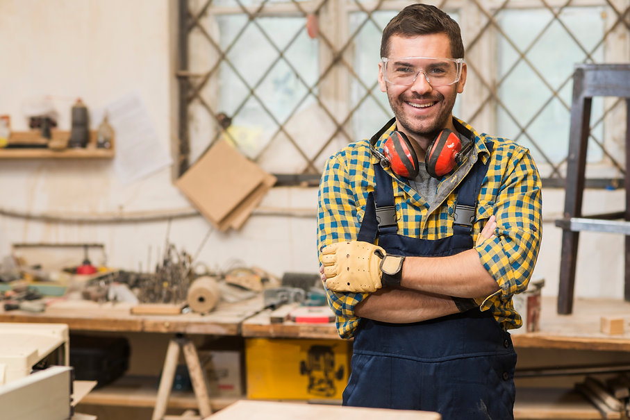 smiling-male-carpenter-wearing-safety-gl