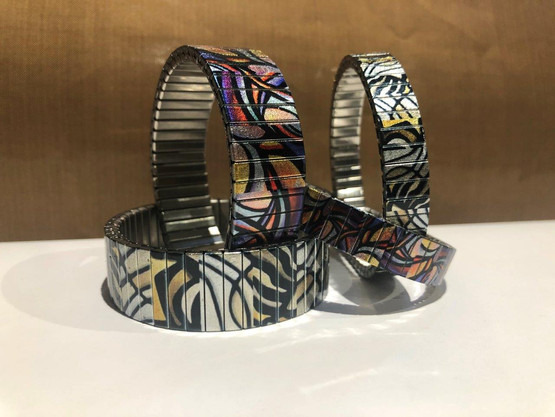 Checkers Kites metallic bracelets by Urband London