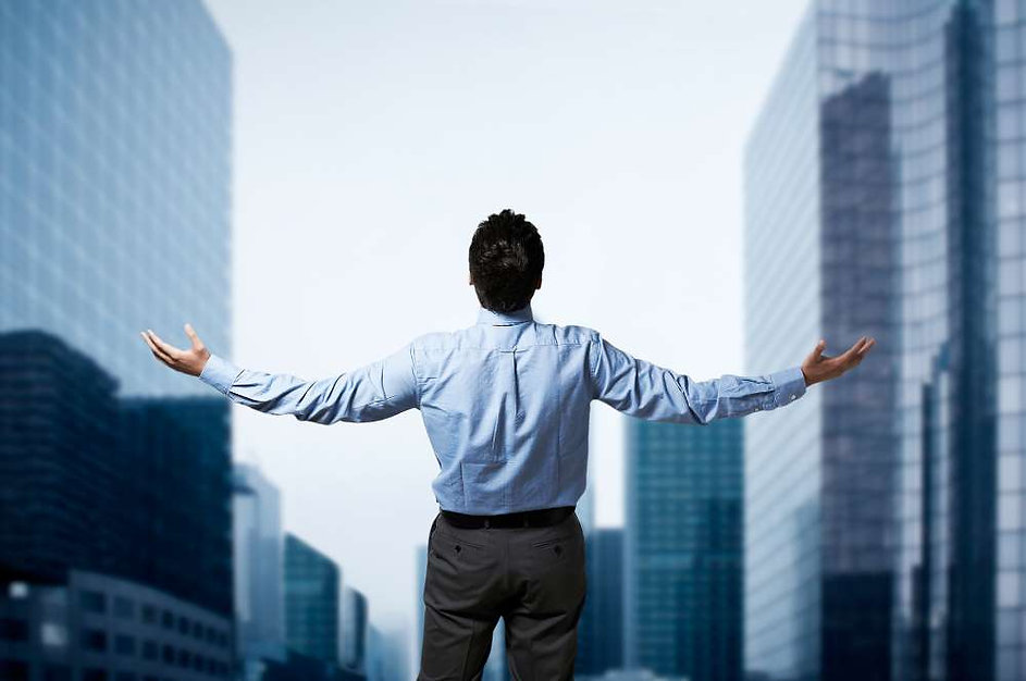 This image is of a man with his arms out in a downtown which is suggesting a business assessment.