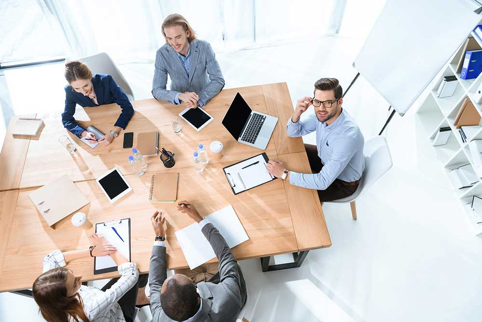 This image is of business people around a table that represents our page about us.