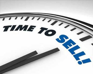 Time to Sell on a clock representing selling a business.
