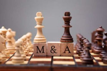 A Chess Board with M&A representing mergers and acquisitions.