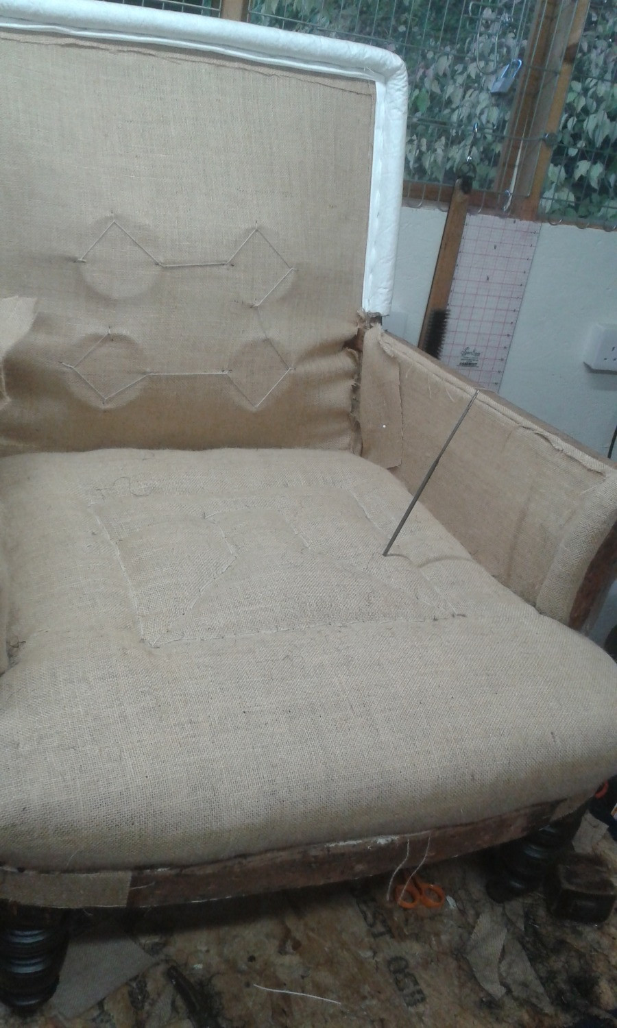 The seat has had it's first stuffing and a layer of hessian has been applied ready for stitching which forms the shape of the seat and firms up