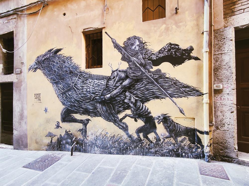 Street art in Via della Viola, Perugia, Umbria. Guerriera dei boschi