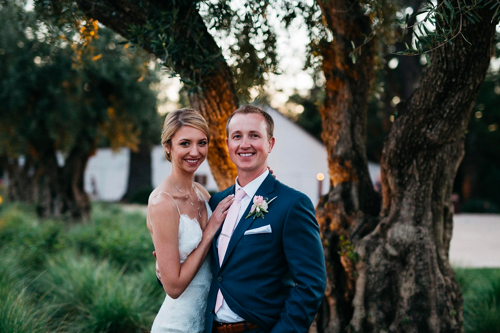 Bride & Groom in front of olive tree napa