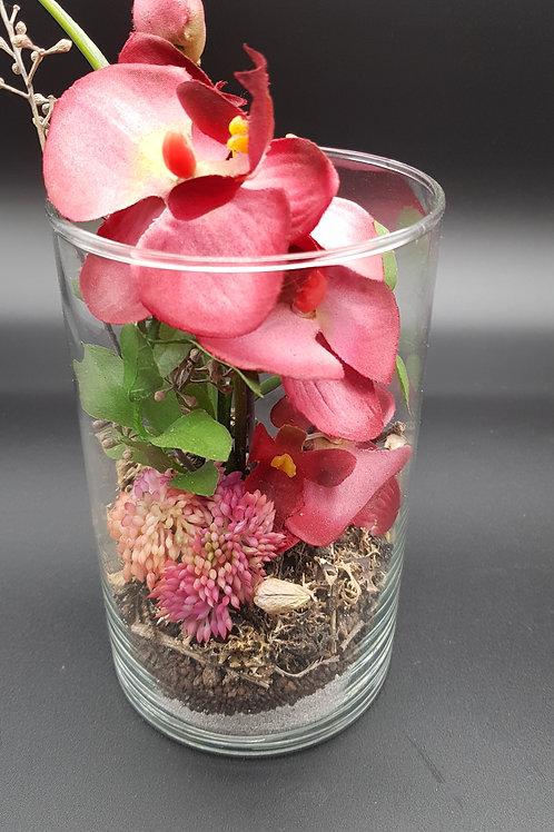 Glas mit Orchidee