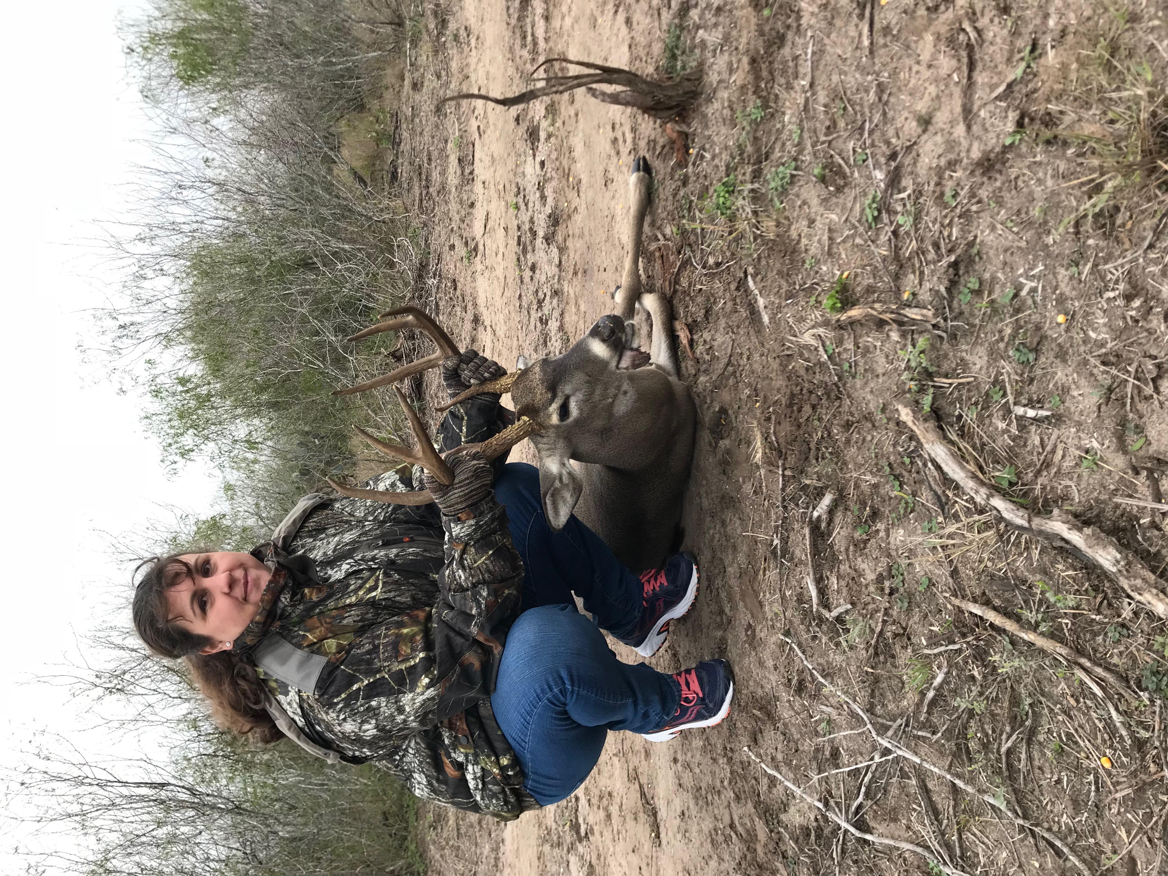 She smoked this mature buck at 140 yards. Great shot.