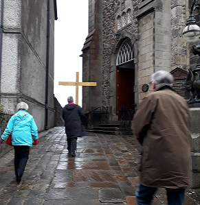 Walking with Cross up to Church.png