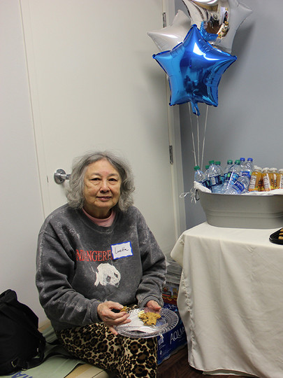 Loretta Lai enjoys some light refreshments at an Access Primary Care Physicians open house.