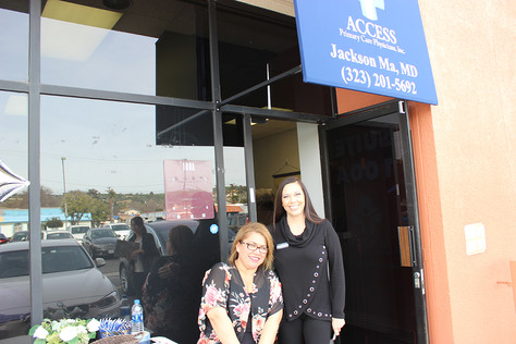 Carmen Aranda (left) and Eva Mendez greeted seniors and their families at an Access Primary Care Physicians' open house.