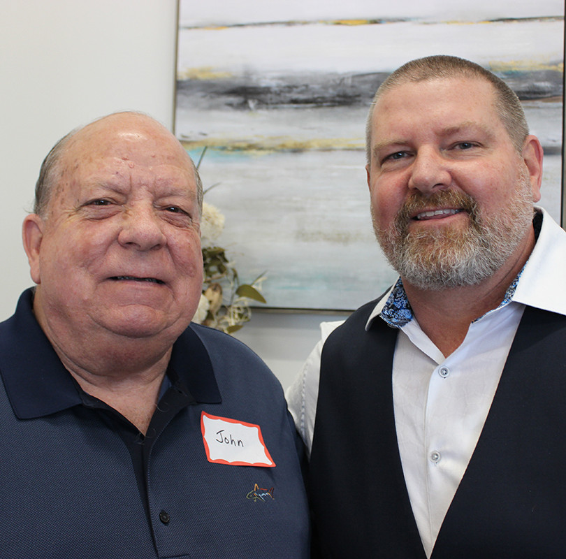 Access Primary Care Physicians co-founder and managing partner Dr. Joseph Rossini, DO (right) chats with John Phillips at an open house.