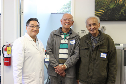 Martin (center) and Frans Coenraad with Dr. Jackson Ma at an Access Primary Care Physicians open house.