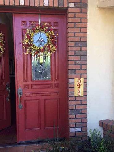 Yellow and red vertical door entry plaque