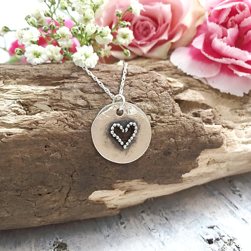 Rustic sterling silver 15mm disc with cutout heart and beaded heart detail