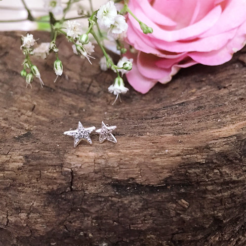 Hand cut sterling silver reticulated star earrings