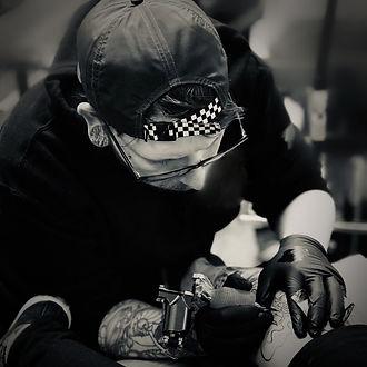 Ryan tattooing.jpg