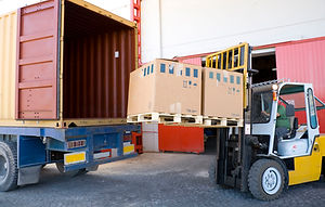 forklift-with-boxes-by-open-truck-172304