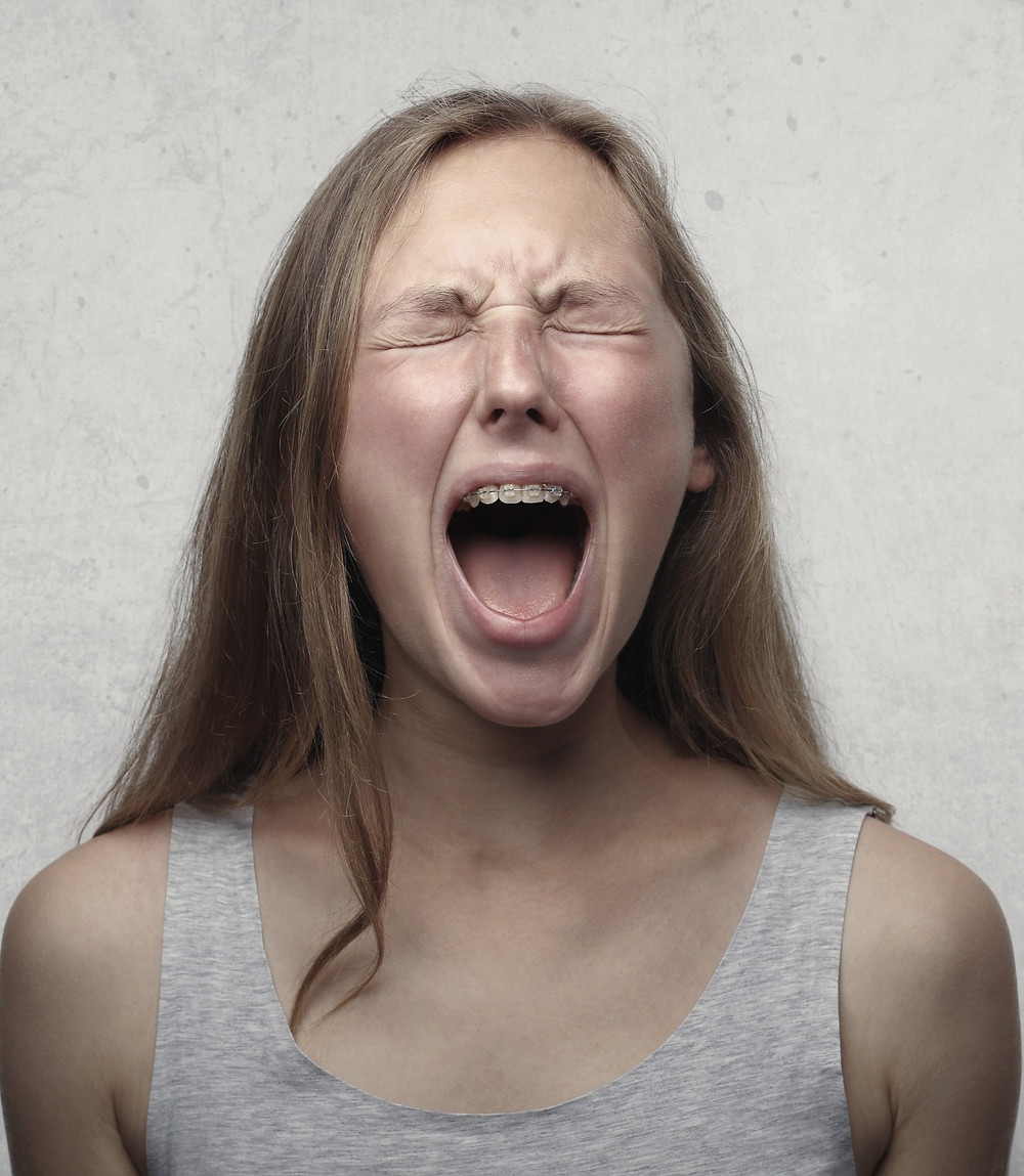 Woman Screaming in Frustration