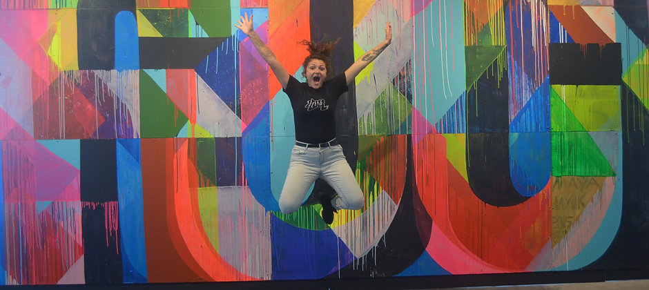 kady jumping at beyond the street art exhibit in Brooklyn, NYC
