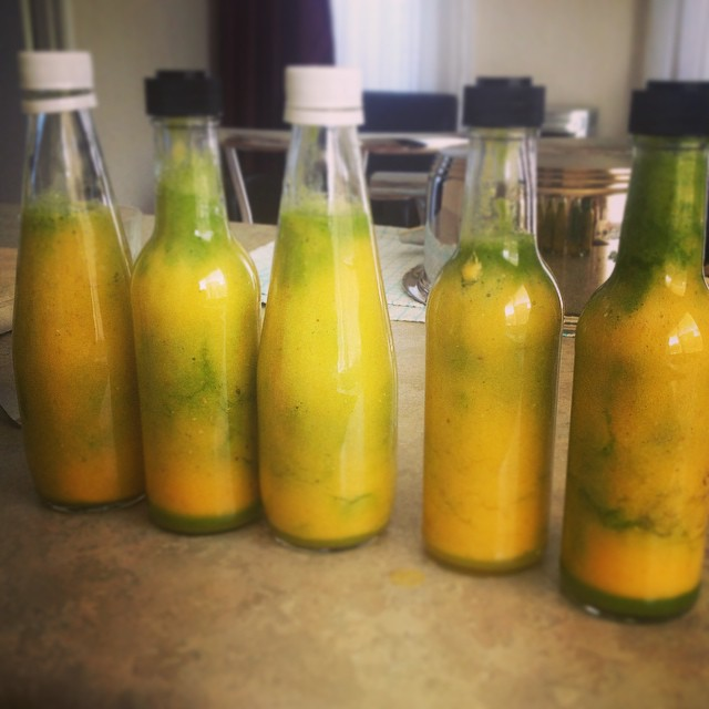 Sharing is caring! Made a huge batch of pineapple lime spinach and mint green smoothie and bottled f