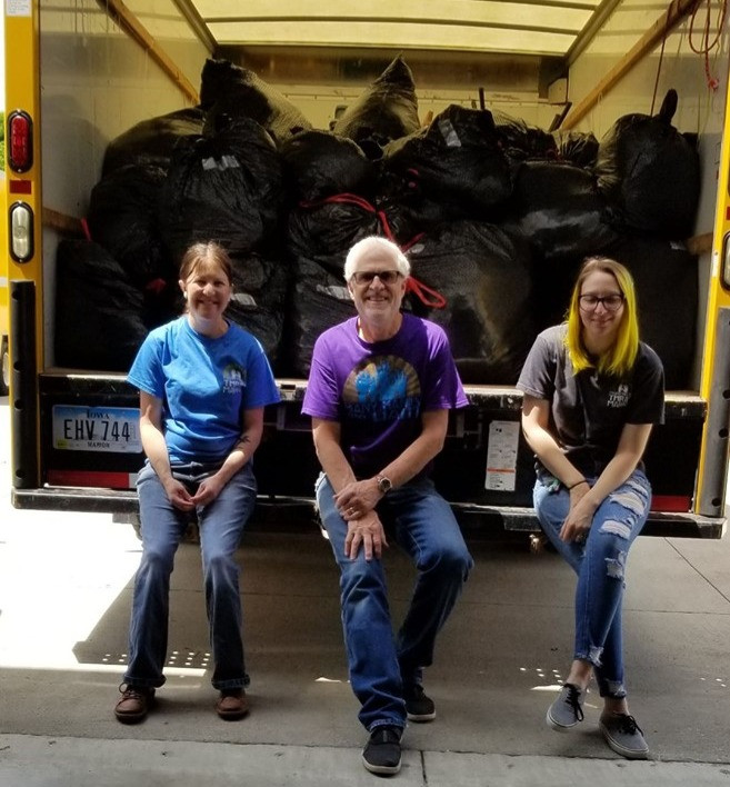 (L-R) Leanne, Jeff, Korissa in front of a 2019 clothing donation to CISS