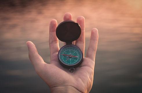Hand Holding Compass.jpg