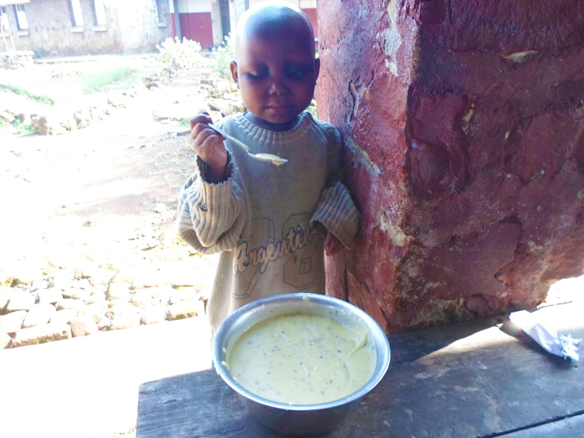 Girl eating porridge