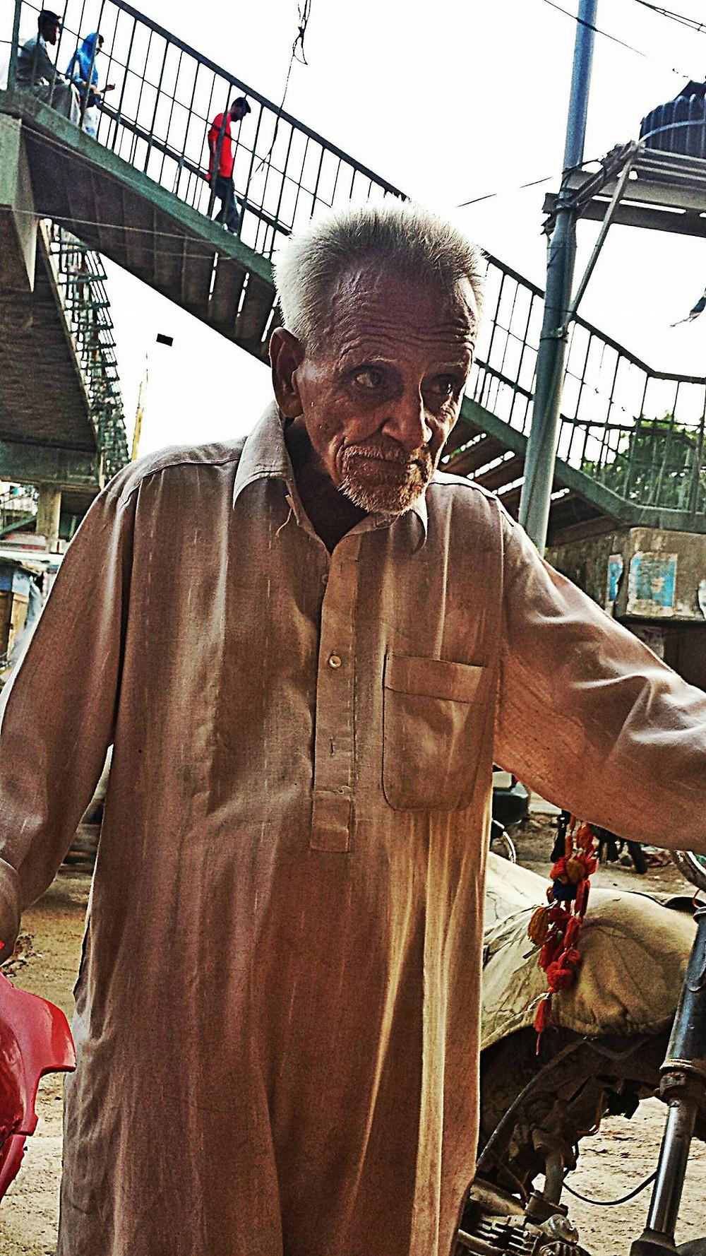 Zafar, age 65, is a beggar in Malir Kala Board.