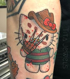Freddy Kreuger Hello Kitty tattoo by Tita Jewels