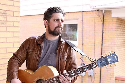 Joel Lindsey with guitar.jpg