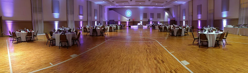 Gymnasium wedding dressed up with uplights!