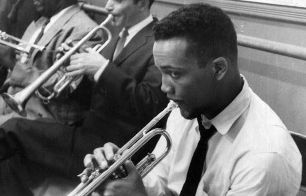 Quincy Jones playing trumpet