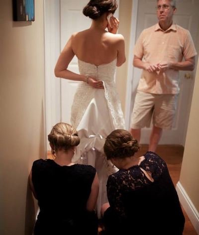 After we pulled ourselves together, Emily called her Grandma and Grandpa in Iowa, both in their 90's, who were unable to make the long trip to the wedding. A good use of her time while her sisters tied up the bustle on her dress.