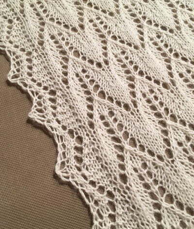 Because I love to knit and am always up for a challenge, I offered to make this keepsake bridal shawl for Mary in case the weather was chilly for their outdoor reception.