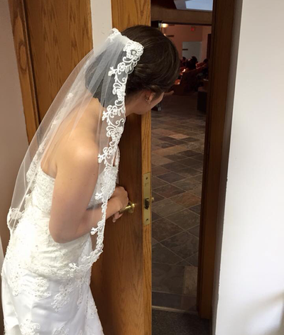 Emily couldn't resist peaking out so she could hear the beautiful prelude music, and this gave a nice photo opportunity to show the veil I made for her. I loved the simplicity and elegance, very fitting for this beautiful bride.