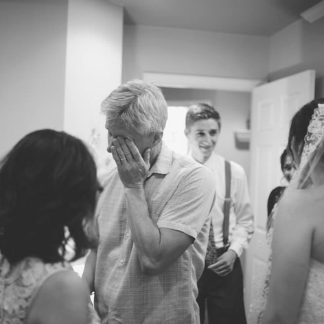 """Emily requested a """"first look"""" just with her immediate family. My husband was not quite prepared to see his little girl as a bride...he may have been the first, but he was not the only one to cry in that special moment."""