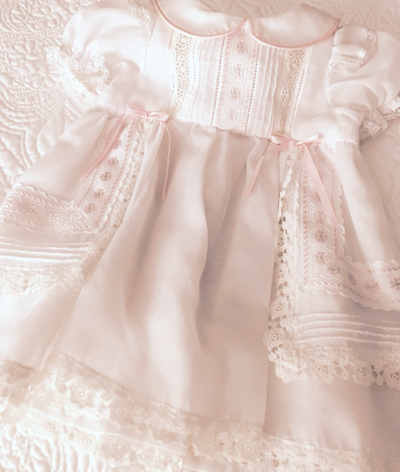 This is the little party dress Katie wore after we changed her out of the vintage Christening gown she wore on that hot August day ~ 1995