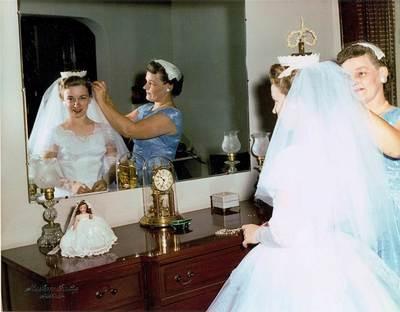 My grandma helping my mom with her veil ~ 1958